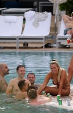 Ellie Brown Wears a tiny bikini and attracts plenty of attention by the pool in Miam