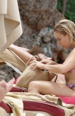 Gabby Allen Shows off her toned figure at the beach in Barbados