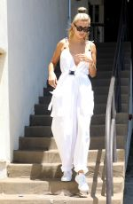 Hailey Baldwin Dons white jumpsuit with matching Adidas sneakers while out with friends in L.A. this afternoon