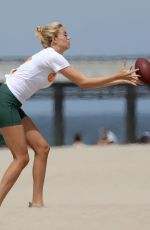 Hailey Clauson Playing flag football on Venice Beach