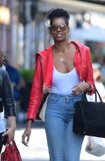 Jessica White Shows Off her Piercings in White Tanktop as she Steps out in NYC