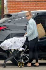Kate Mara Loads precious cargo into her car after taking her newborn baby along to her ballet class in Los Angeles