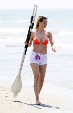 Michelle Hunziker With Tomaso Trussardi prcticing paddling in Forte dei Marmi