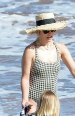 Olivia Wilde In a one-piece at the beach with her kids in Hawaii