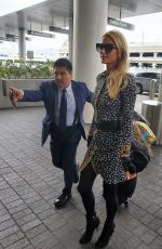 Paris Hilton Catch a flight for Europe with her boyfriend in Los Angeles