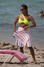 Rocsi Diaz In a neon yellow bikini on the beach in Miami