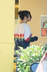 Selena Gomez Exits a LA dermatologist office and assists an elderly woman