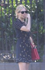 Sienna Miller Wears a floral romper dress and fuschia shoulder bag while out in New York City