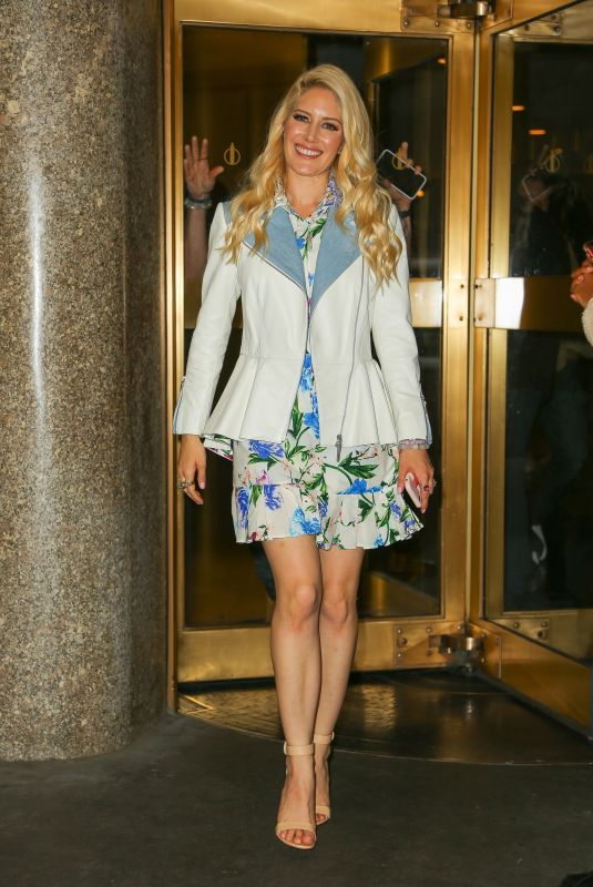 Stephanie Pratt Seen smiling in a floral dress and white jacket as she leaves her hotel in New York