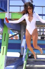 Tao Wickrath In white swimsuit as she takes selfies in Miami
