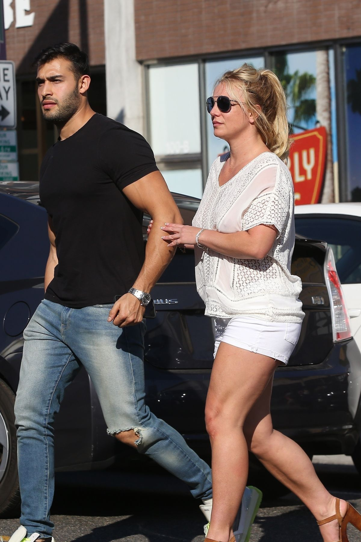 Britney Spears and boyfriend Sam Asghari hold hands while