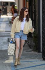 Emma Roberts Leaving Nine Zero One salon as a brunette in West Hollywood