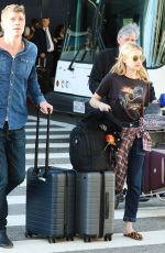 Garrett Hedlund and girlfriend Emma Roberts are seen at Los Angeles Airport