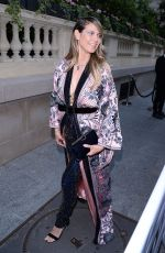 Heidi Klum Attends to amfAR party in Paris