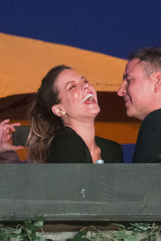 Kate Beckinsale and David Walliams get close to kiss while David Schwimmer watches on at British Summer Time Festival in London