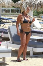 Kerry Katona Making her way to the beach in her skimpy little black bikini on holiday in Mykonos