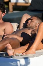 Megan Barton Hanson Shows off her assets at the pool in Crete