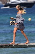 Natasha Poly Arrives at the CluB 55 France St Tropez