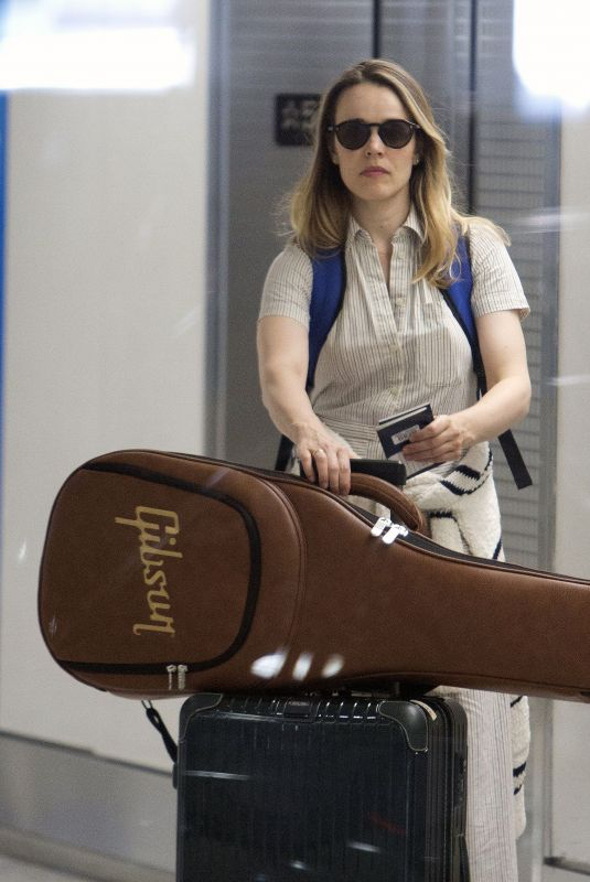 Rachel McAdams In her hometown of Toronto, Canada with a Gibson guitar along with her luggage