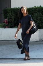 Thandie Newton Sitting at a bus stop before taking an afternoon stroll in Los Angeles