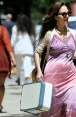 Alexa Ray Joel Wearing a pink slip dress, carries a retro suitcase leaves her apartment in New York City
