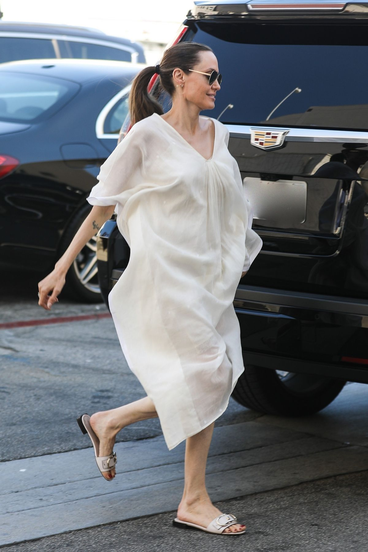 Angelina Jolie Shop for purses at the Yves Saint Laurent ...