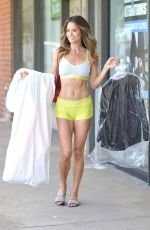 Brooke Burke Picks up her dry cleaning in Malibu