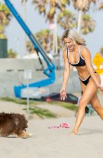 CJ Perry Plays with a dog while at the beach in Malibu