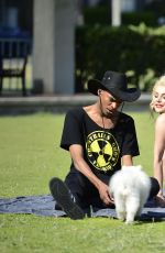 Courtney Stodden In bikini with a dog and a blunt in a park in LA