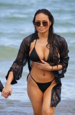 Daphne Joy Shows off her unreal curves in a tiny black bikini on the beach in Miami