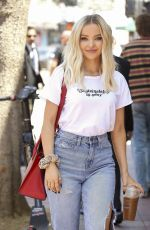 Dove Cameron Is seen carrying a red Prada purse while getting a coffee to go in LA