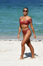 Elisa De Panicis Shows off her curves in a rose colored bikini on the beach in Miami