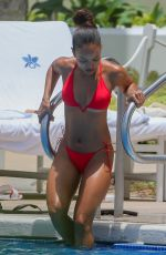 Karrueche Tran Shows off her cheeks in a bikini while out with Victor Cruz, Honolulu
