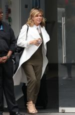 Kate Garraway Rolls back the years in khaki dungarees arriving at Smooth Radio Studios in London