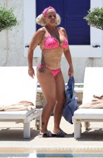 Kerry Katona Strips off her cute denim outfit to reveal a sexy pink bikini in Mykonos