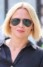 Kimberley Walsh Arrives at Build TV in a Black cropped shirt and Khaki pleated skirt - London