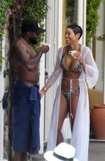 Nicole Murphy Enjoys a dip in the pool at the Regina Isabella hotel in Ischia