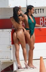 Yovanna Ventura Hits the beach in a thong animal print one piece swimsuit with friends on Sunday afternoon in Miami
