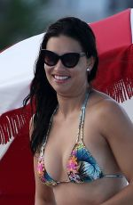 Adriana Lima Wears a tiny string bikini as she hits the beach in Miami