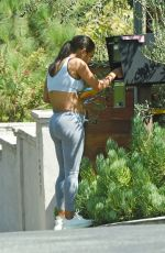 Christina Milian Shows off her growing baby bump as she steps out to check her mailbox in Los Angeles