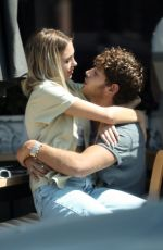 Delilah Hamlin and Eyal Booker pack on the PDA in West Hollywood