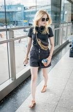 Ellie Bamber Arriving at Heathrow Airport in London