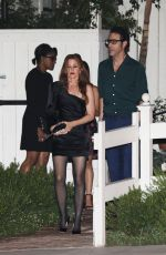 Isla Fisher and Sacha Baron Cohen meet up with friends for a dinner party in West Hollywood