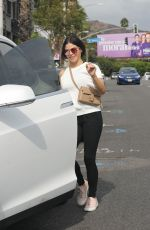 Jenna Dewan Returns to her Tesla after a business meeting in West Hollywood