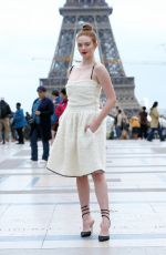 Larsen Thompson Poses in front of the Eiffel Tower after Rochas SS20 during Paris Fashion Week