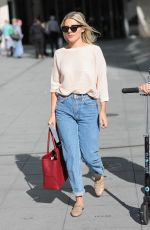 Mollie King Looks chic in cream and denim as she exits BBC studios
