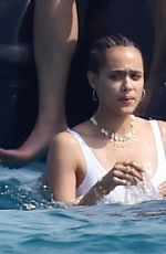 Nathalie Emmanuel Dons her white swimsuit out in the blazing hot sunshine on holiday with her beau Alex Lanipekun in Italy