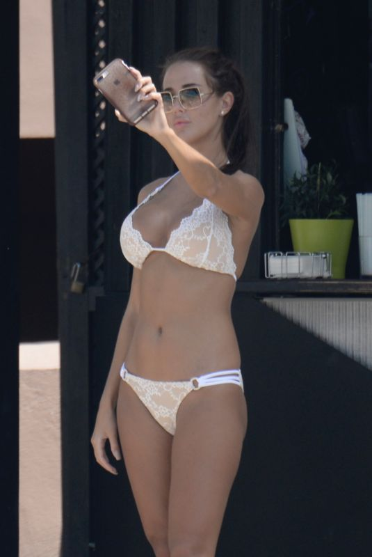 Yazmin Oukhellou Poolside in Marbella