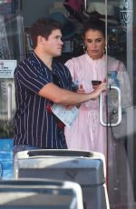 Adam DeVine and his new fiance Chloe Bridges look glum while picking up snacks at a Hollywood gas station