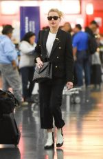 Amber Heard Landing at John F. Kennedy Airport in New York City